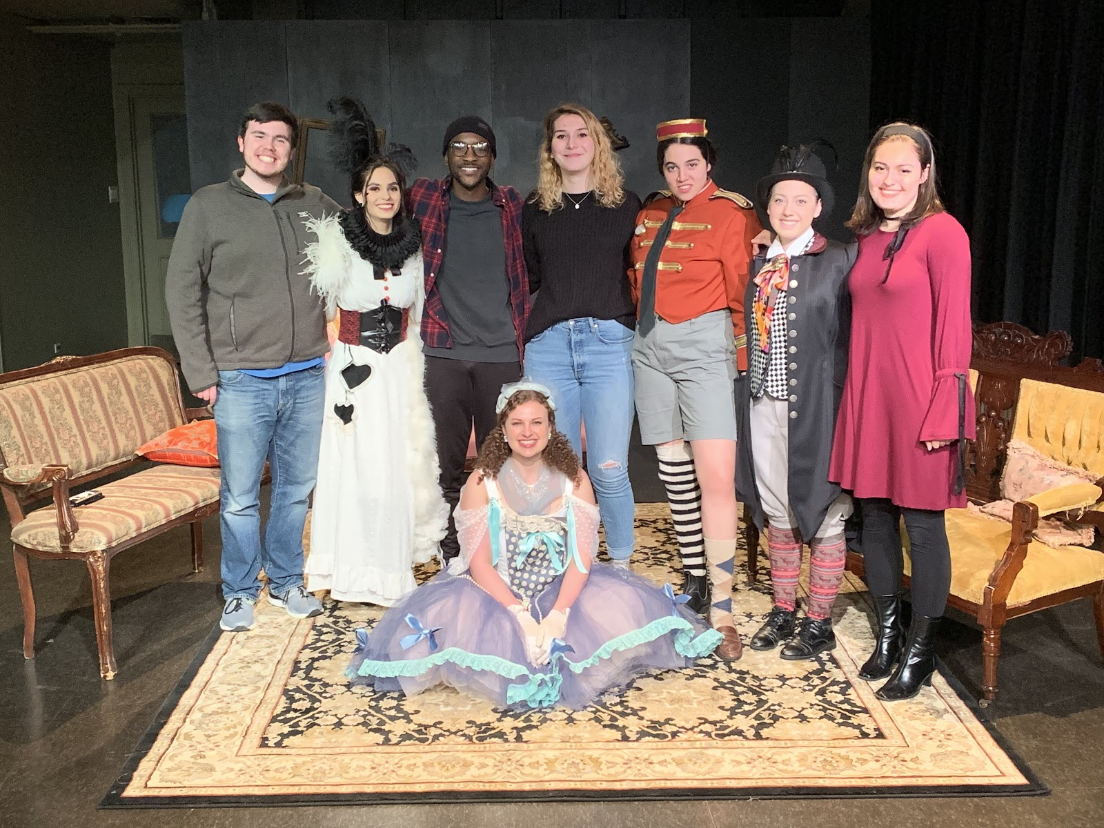 Declan Rockett '20, Scarlett Diaz-Power '20, me, Morgan Grant '20, Mia Barbuto '22, Becca Collins '21, Carly Sponzo '21 and Sonia Joffe '19 pose in their costumes on the set of No Exit