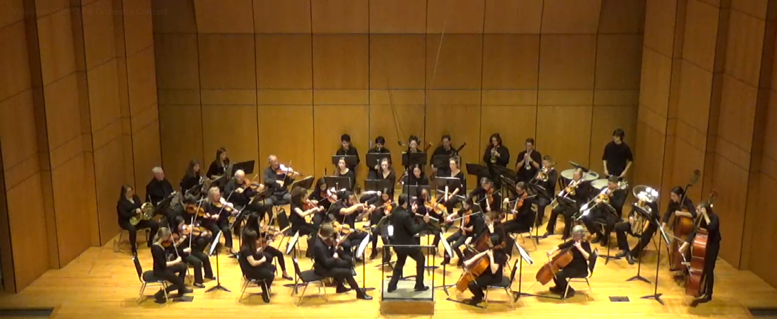 A view of the orchestra playing on stage at Conn.