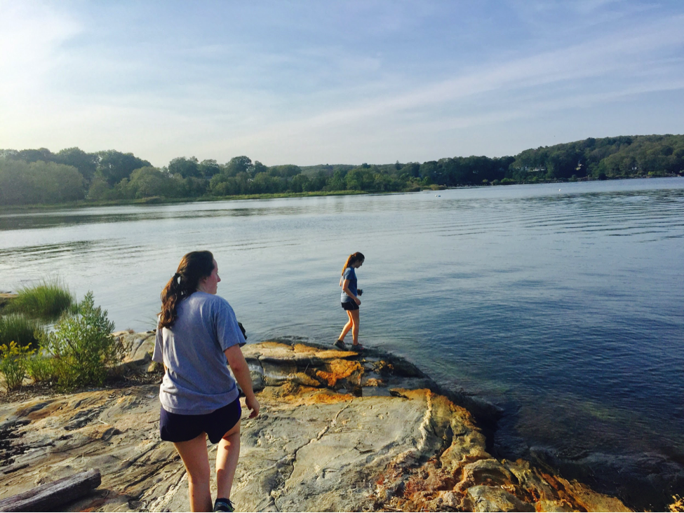 Avery Lowe '18 explores the water's edge at Mamacoke Island.