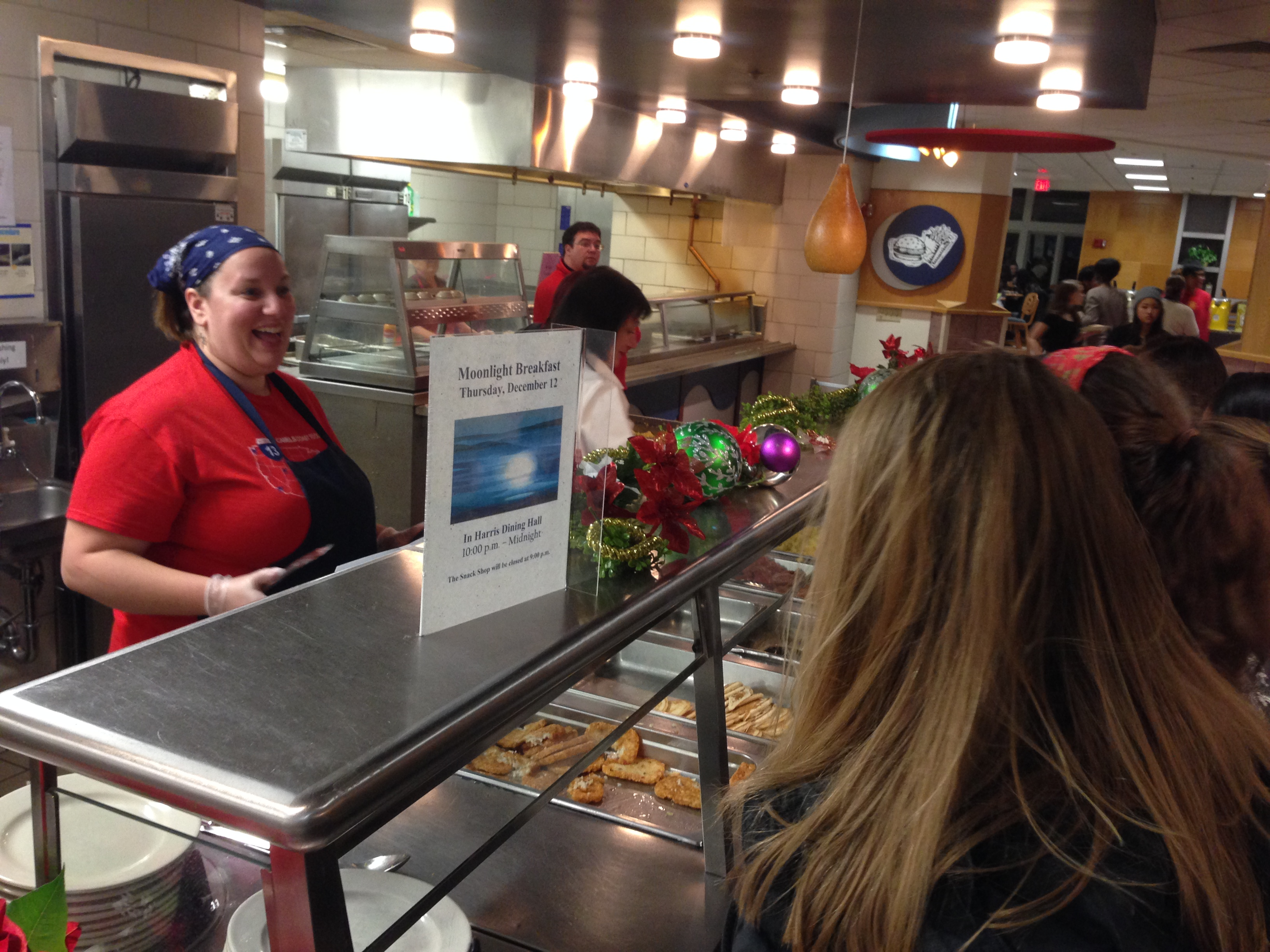 Director of Residential Education and Living serves food to students