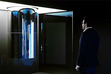 Man stands in front of IBM's quantum computer
