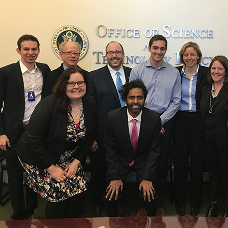 Justin Koufopoulos '10 (back row, far left) and other presidential innovation fellows pose with Chief Technology Officer of the United States Megan Smith (second from right).