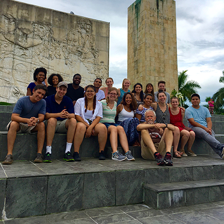 Students who took part in the fall 2016 Study Away Teach Away to Cuba and Mexico sit on the steps of the Che Guevara Mausoleum in Santa Clara, Cuba.