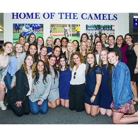 Members of the 1998 women's soccer team pose with current women's soccer players at the Hall of Fame induction ceremony.