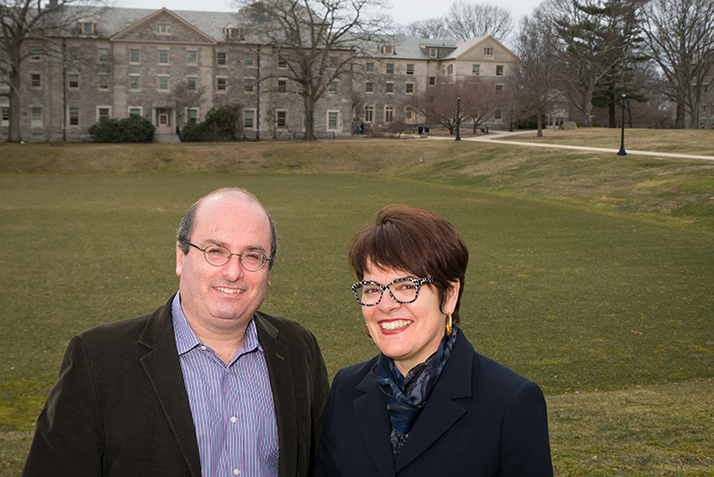 David Grann and President Katherine Bergeron pose in front of the College's Tempel Green.