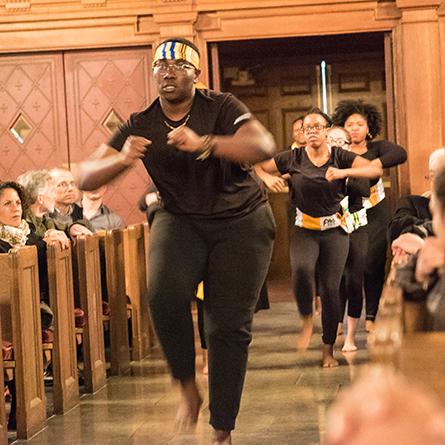 "Bempa Ashia '20 leads fellow dance students in the opening performance at the ""Dreaming of Another World"" event in Connecticut College's Harkness Chapel Jan. 27."
