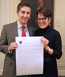SGA President Evert Fowle '14 (left) and President Katherine Bergeron with a copy of the College's shared governance covenant.