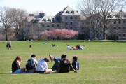 Students sitting on Tempel Green.